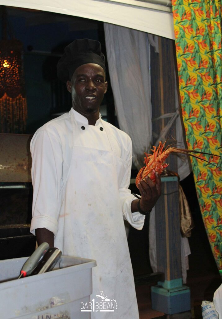 Chef preparing lobster at the St. Lucia Food and Rum Festival