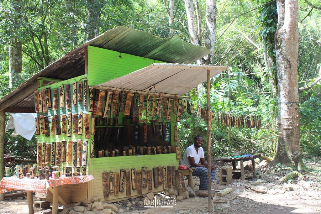 Small local stall selling hand made wooden items Argyle Waterfall in Tobago
